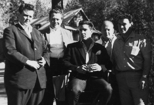 Fike (left) with Elvis (seated) and other members of the Memphis Mafia on the set of the 1962 film 'Kid Galahad'