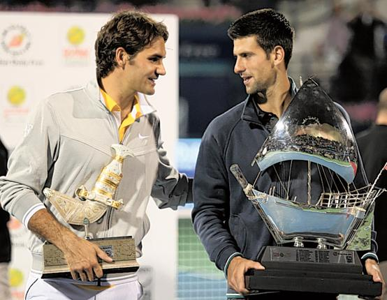 Roger Federer (left) congratulates Novak Djokovic on his victory