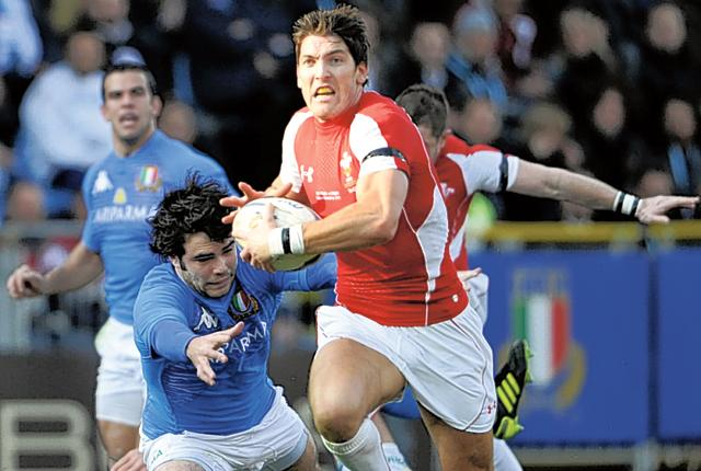 James Hook evades a tackle during Wales's win over Italy in Rome
