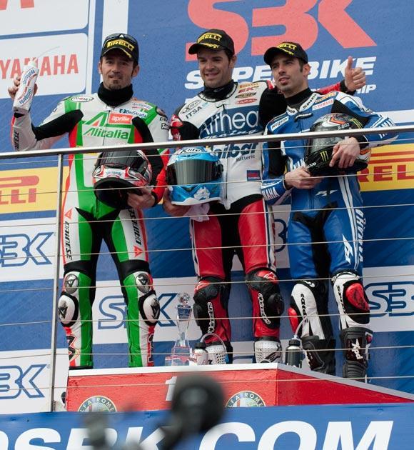 Max Biaggi of Italy and Aprilia Alitalia Racing Team, Carlos Checa of Spain and Althea Racing and Marco Melandri of Italy and Yamaha World Superbike Team celebrate on the podium yesterday