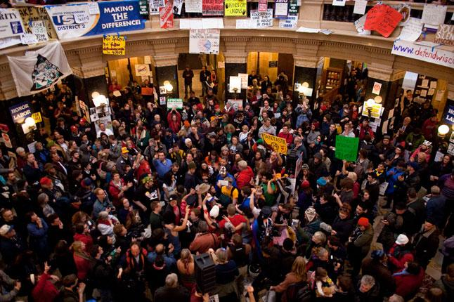 Demonstrators occupy the Wisconsin State Capitol in protest at proposed budget cuts