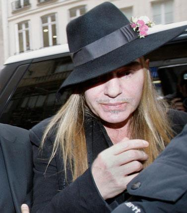 John Galliano arrives at the police station in Paris