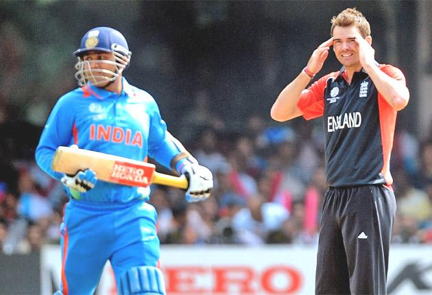 England's James Anderson shows his angst against India on Sunday as Virender Sehwag watches the ball head for the boundary