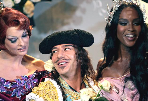 John Galliano on the catwalk with Linda Evangelista and Naomi Campbell at the end of his autumn/winter show for Christian Dior in 2007