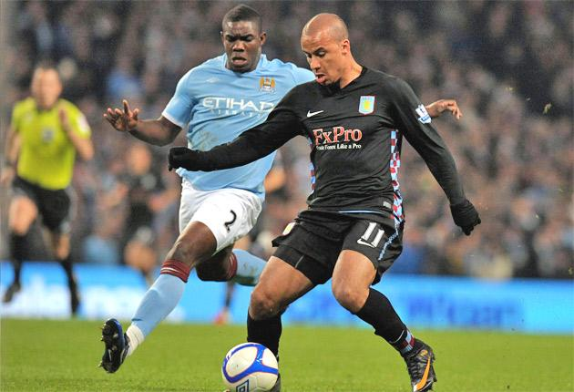 Micah Richards (left) and Aston Villa's Gabriel Agbonlahor tangle on Wednesday night