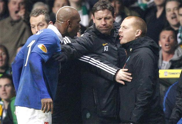 Rangers' El Hadji Diouf (left) and Celtic manager Neil Lennon are separated at Celtic Park on Wednesday