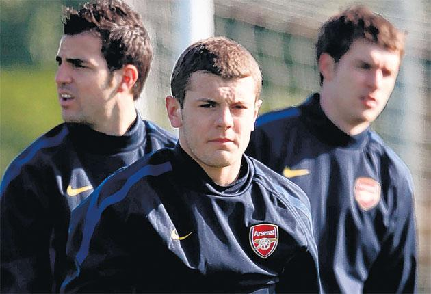 Cesc Fabregas (left) leapt to the defence of Jack Wilshere (centre) after yesterday