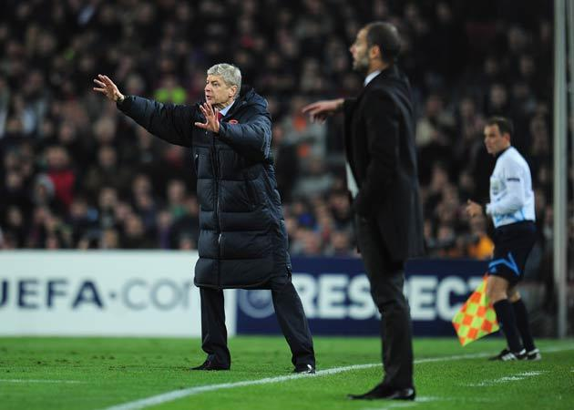 """<b>WENGER LOSES IT AT THE NOU CAMP</b><br/> Incensed by the referee's decision to show Robin van Persie a yellow card for time wasting, Wenger got involved in an angry verbal exchange at the final whistle. He claimed today: """"We have done nothing wrong. Th"""