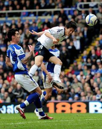 Chung at heart: Bolton's Lee Chung-Yong heads the winner past the Birmingham goalkeeper Ben Foster to put Bolton into a Wembley semi-final