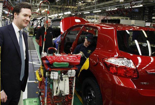 Motorists' friend? George Osborne at a car factory in Derby last week