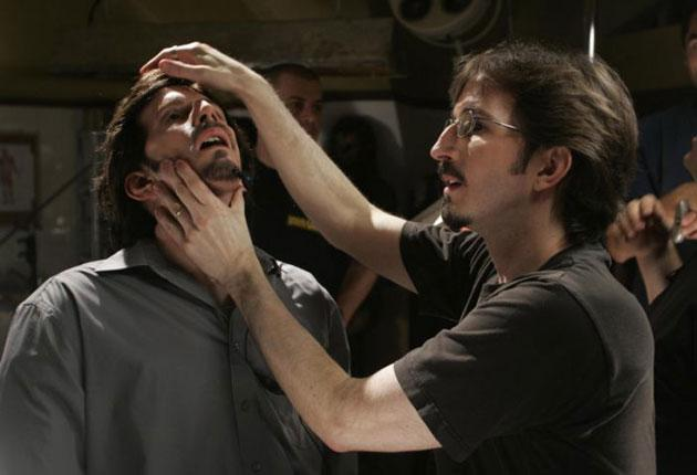 Tony Gardner, right, works on a model of himself for the 2004 film 'Seed of Chucky