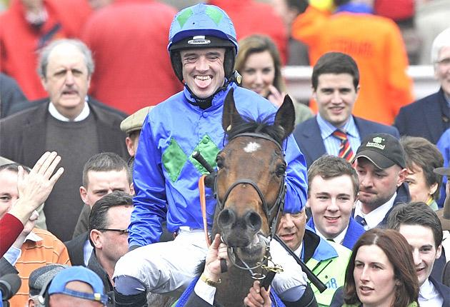 Ruby Walsh wears a broad smile after winning the Champion Hurdle