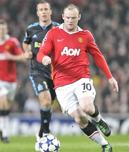 Wayne Rooney keeps his eye on the ball during Manchester United's Champions League victory over Marseilles at Old Trafford last night