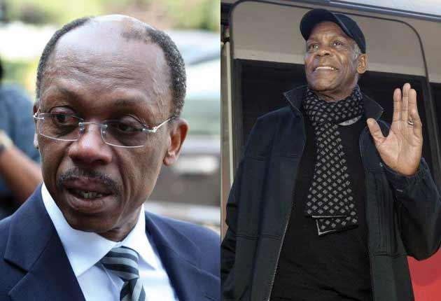Mr Aristide plans to return to Haiti today accompanied by Danny Glover, right