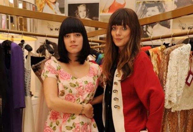 Lily Allen can barely hide her lack of excitement with the fashion world as she joins sister Sarah in checking out their clothing range