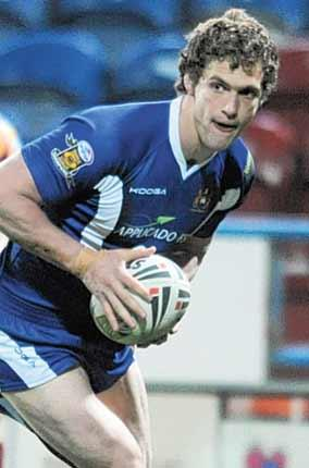 Wigan's Sean O'Loughlin crosses for his team's first try last night