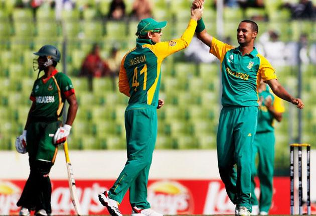 Robin Peterson of South Africa celebrates with team mates after taking the wicket of Shafiul Islam of Bangladesh caught by Graeme Smith