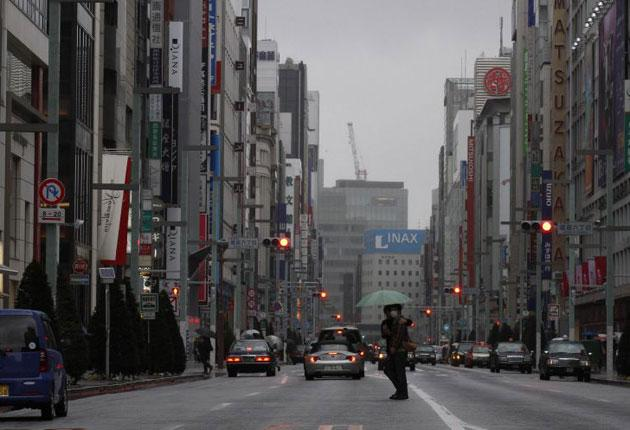 Amidst fears of a nuclear catastrophe in northeastern Japan, a smaller than usual number of people were seen in Tokyo's popular shopping district of Ginza despite today being a national holiday