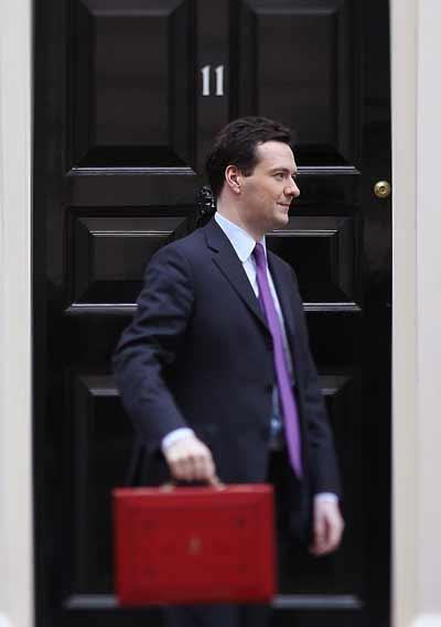 George Osborne leaves 11 Downing Street for Parliament