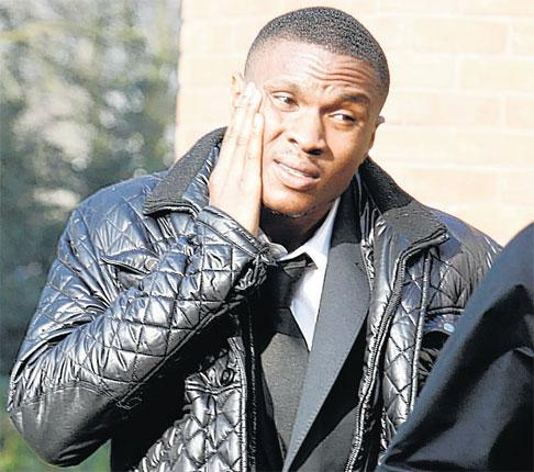 Kelvin Etuhu, the former Manchester City forward, arrives at Warrington Crown Court where he was sentenced to eight months in prison yesterday