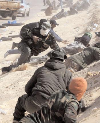 Rebel fighters under attack near Ajdabiya