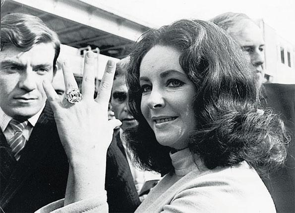 Showing off the 33 carat diamond given to her by Richard Burton in 1968