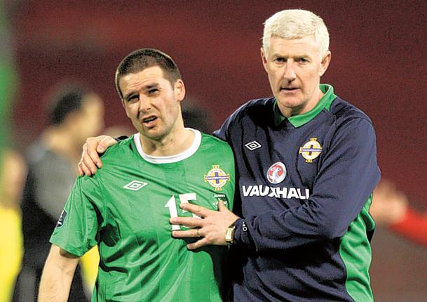 Northern Ireland's David Healy (left) is consoled by manager Nigel Worthington last night