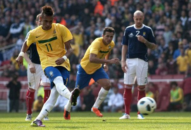 Neymar scores from the penalty spot during Brazil's 2-0 win over Scotland