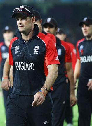 Andrew Strauss leads England off after their World Cup quarter-final defeat to Sri Lanka on Saturday