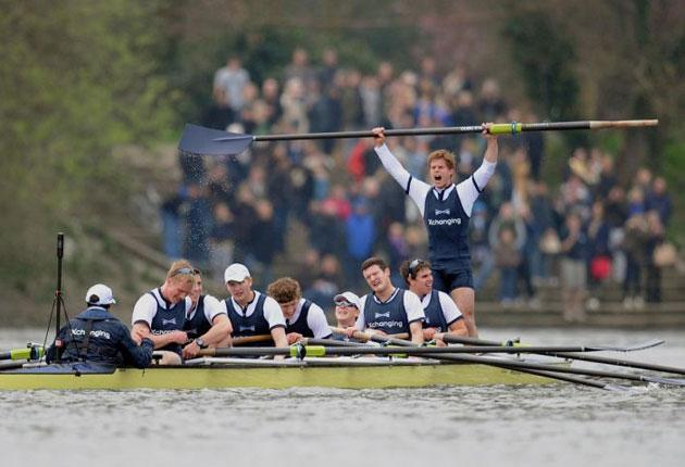 Oxford bow Moritz Hafner (right) leads the celebrations after Saturday's Boat Race victory
