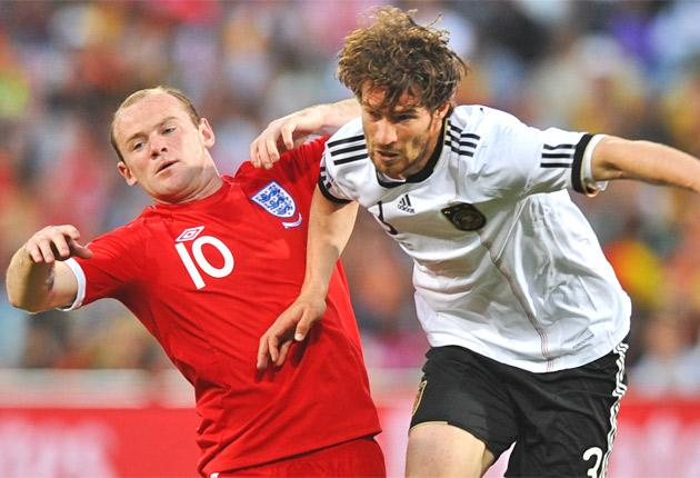 Wayne Rooney (left) struggles against Germany's Arne Friedrich at the last World Cup