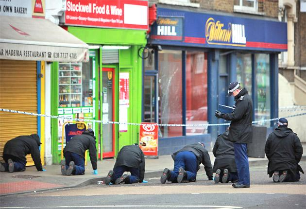 Police officers search the crime scene yesterday
