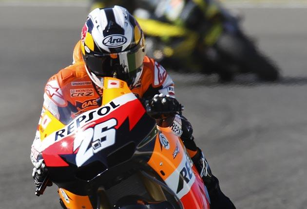Dani Pedrosa lifts a wheel accelerating out of a corner in Jerez yesterday