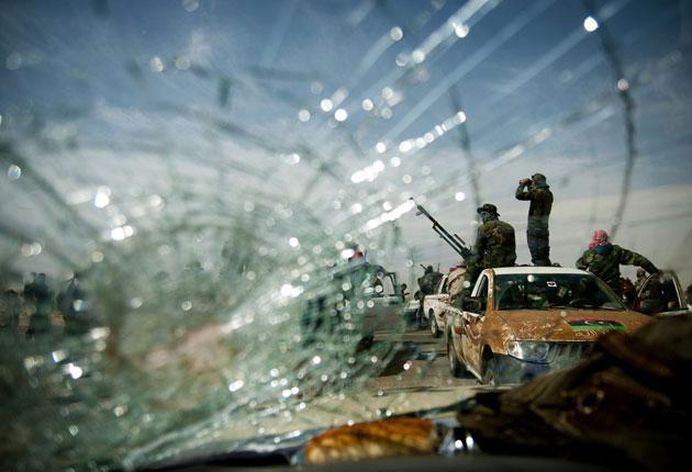 Rebel soldiers at a checkpoint near Brega: many are untrained gunmen in pick-up trucks