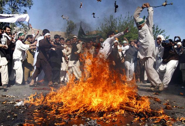 Protesters set ablaze an effigy of Barack Obama in Jalalabad
