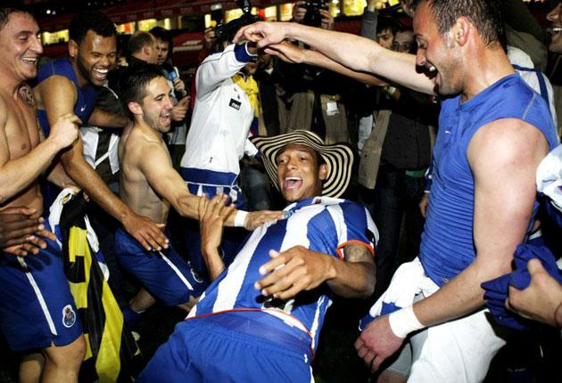Porto's Fredy Guarin limbos in celebration after his side's 2-1 victory at fierce rivals Benfica secured the Portuguese title