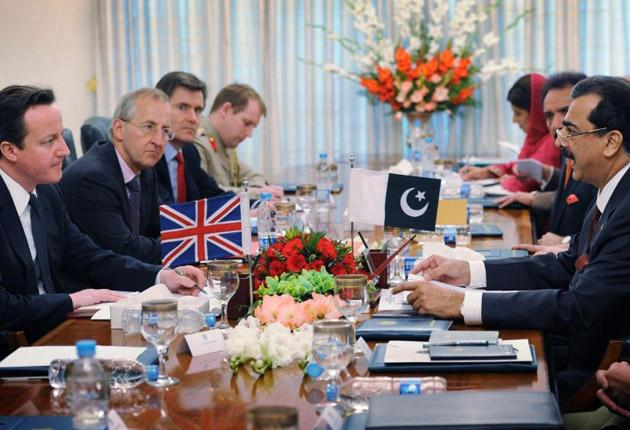 David Cameron at a meeting with British and Pakistani security chiefs led by his Pakistani counterpart Yousuf Raza Gilani (right) and attended by MI6 chief Sir John Sawers (second from far left)