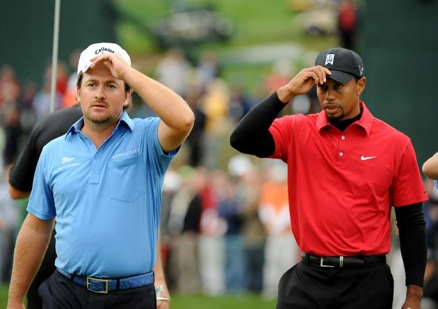 Graeme McDowell and Tiger Woods pictured at the World Challenge in December