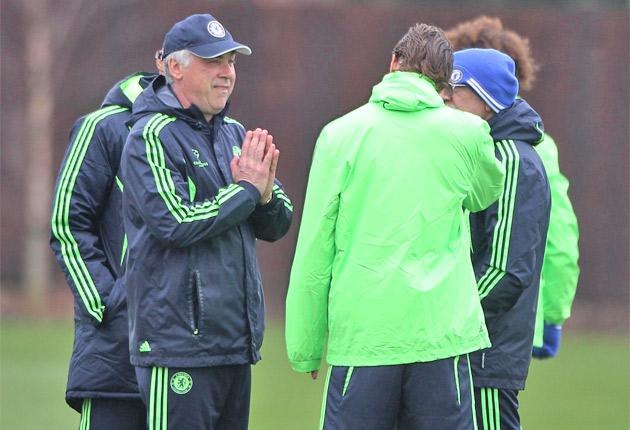 Carlo Ancelotti appears yesterday to be asking a higher power for Fernando Torres to rediscover his form and help keep his manager in a job