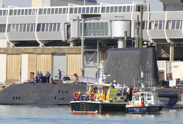 Police at Southampton dock, where a submariner was shot on board HMS Astute, the Royal Navy's newest nuclear submarine, which was on a goodwill visit