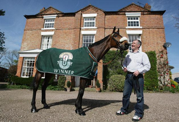 Trainer Donald McCain at home yesterday with his Grand National winner Ballabriggs