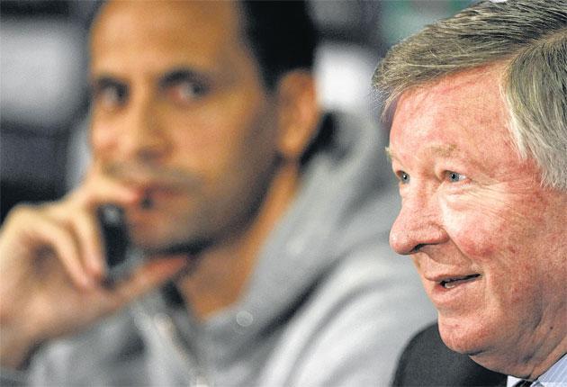 Rio Ferdinand looks on as Sir Alex Ferguson warms to his theme yesterday