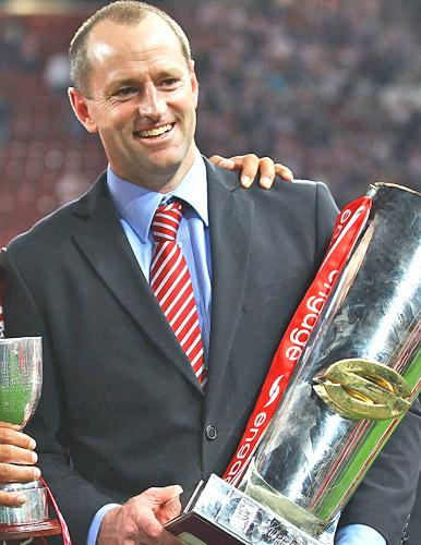 Michael Maguire with the Super League trophy after Wigan's victory last year