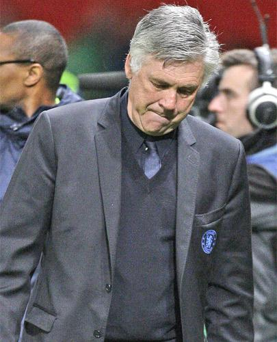 Carlo Ancelotti trudges off after Tuesday's defeat by Manchester United