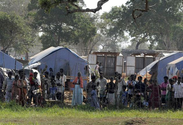 Sri Lankan Tamils captured by government forces and held in a camp for displaced people in the northern district of Vavuniya in 2009. Some were not allowed home for a year