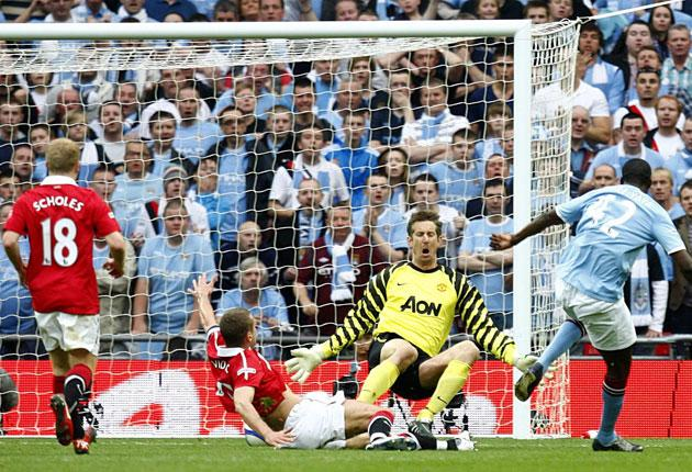 Yaya Touré (right) slots in City's winner at Wembley yesterday