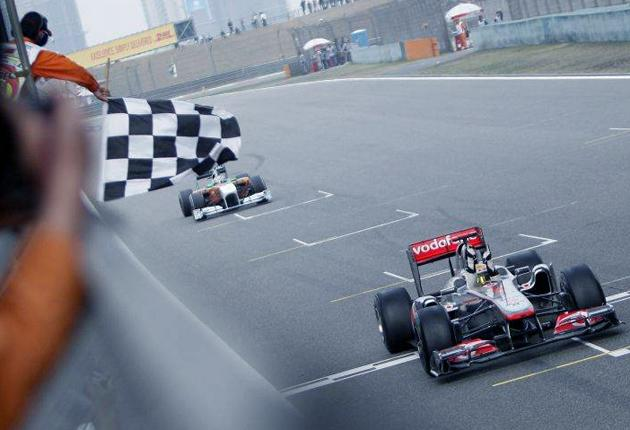 Lewis Hamilton crosses the finish line to win the Chinese Formula One Grand Prix