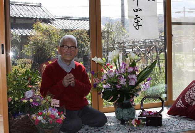 Jirouemon Kimura poses on his 114th birthday at his home in Kyotango, western Japan