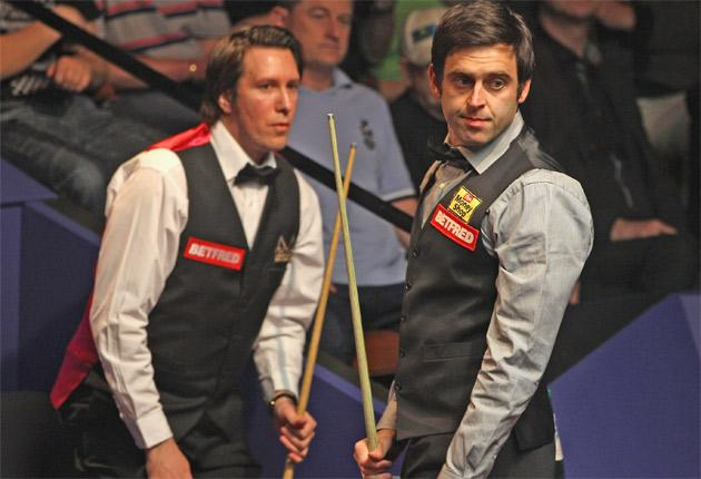 Ronnie O'Sullivan (right) on his way to a 10-2 victory over Dominic Dale