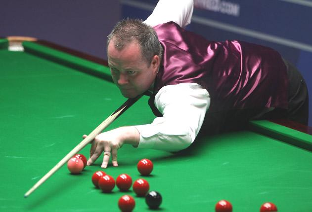John Higgins hit three century breaks as he opened up a lead on Stephen Lee